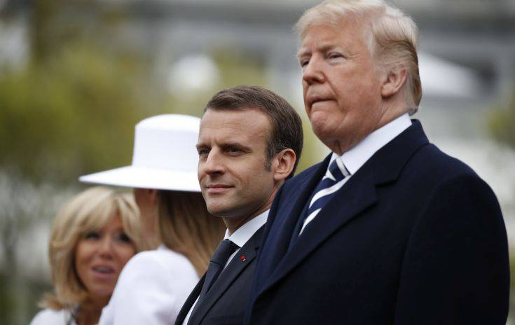 President Donald Trump, French President Emmanuel Macron, first lady Melania Trump and Brigitte Macron stand during a State Arrival Ceremony on the South Lawn of the White House in Washington, Tuesday, April 24, 2018. (AP Photo/Carolyn Kaster)